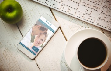 Dating website against smartphone on table