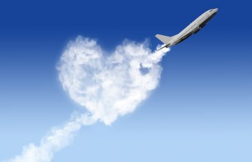 heart shape cloud and plane on blue background