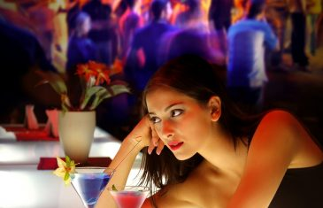 woman drinking cocktail during a party