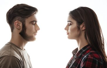 Side view. Closeup portrait of man and woman facing each other with eyes closed.