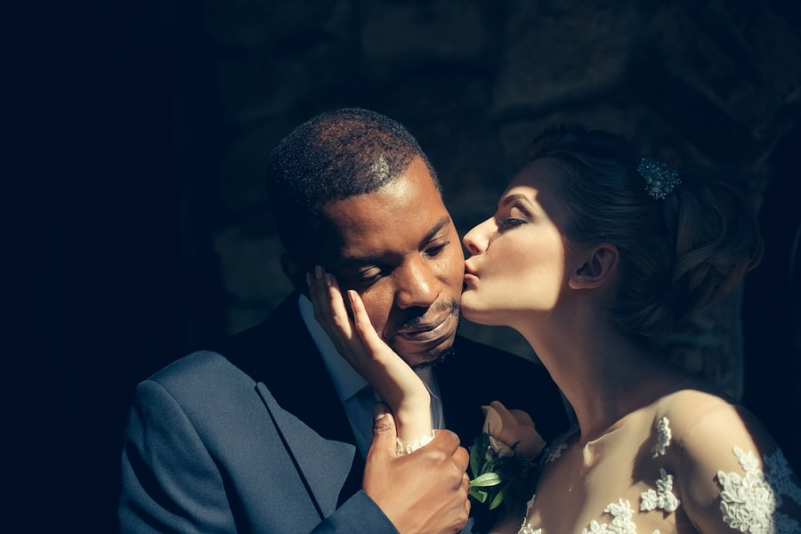 beautiful bride kissing tenderly handsome man