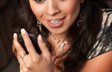 Beautiful Woman Receiving Call or Text on her Cell Phone