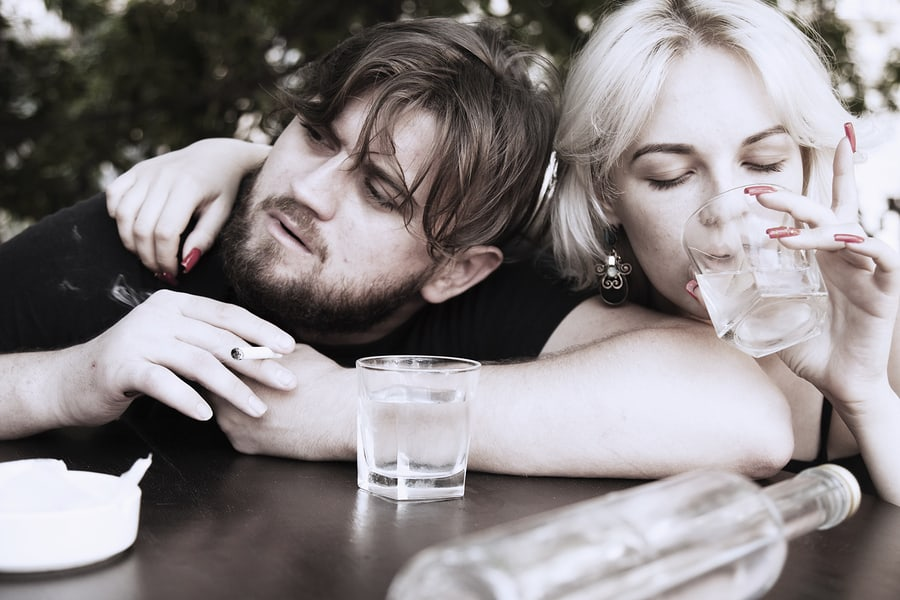 Couple smoking and drinking alcohol