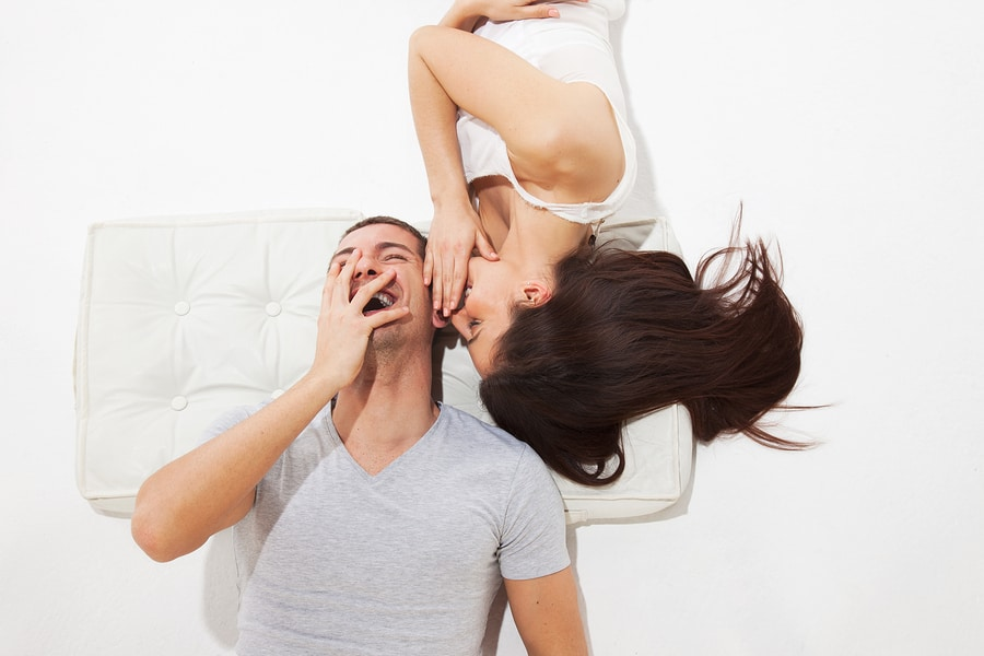 Young Couple Lying whispering