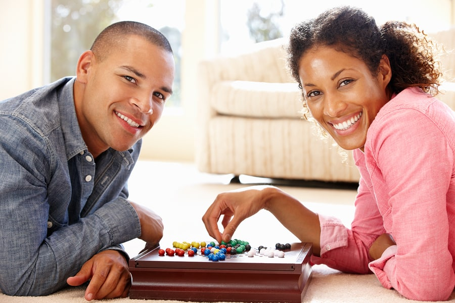 couple playing board game on date night