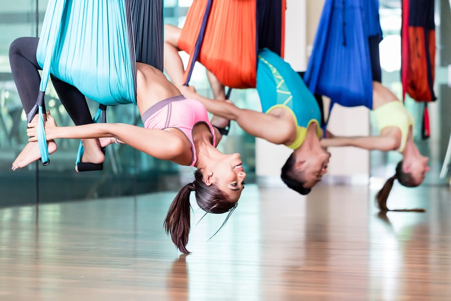 Taking Up Aerial Yoga and Its Benefits for Health and Wellness
