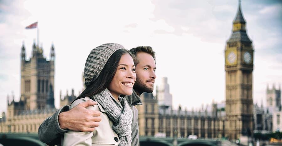 Happy couple by Big Ben Parliament, River Thames, London. Romant