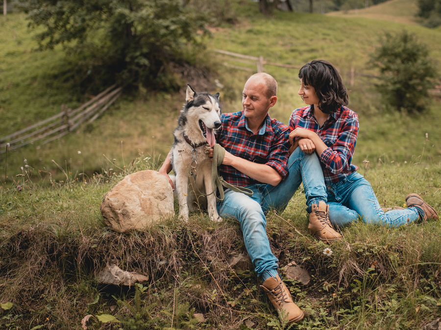 happy couple with dog in spring