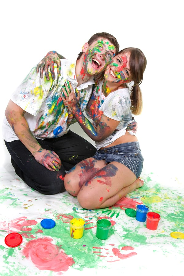 Young Happy Couple Painting