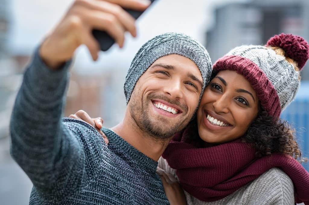 Happy multiethnic couple on christmas holidays.